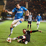 Fraser Aird jumps over Alex Whittle's tackle