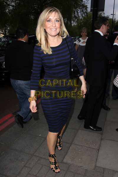 FIONA PHILLIPS.At the Sony Radio Academy Awards, Grosvenor House Hotel, Park Lane, London, England, UK, May 10th 2010..full length blue and black navy striped dress gladiator sandals open toe gold studs studded bracelet smiling bag .CAP/AH.©Adam Houghton/Capital Pictures.