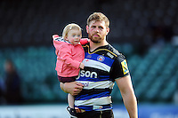 Dave Attwood of Bath Rugby looks on with his daugter after the match. Aviva Premiership match, between Bath Rugby and Sale Sharks on April 23, 2016 at the Recreation Ground in Bath, England. Photo by: Patrick Khachfe / Onside Images