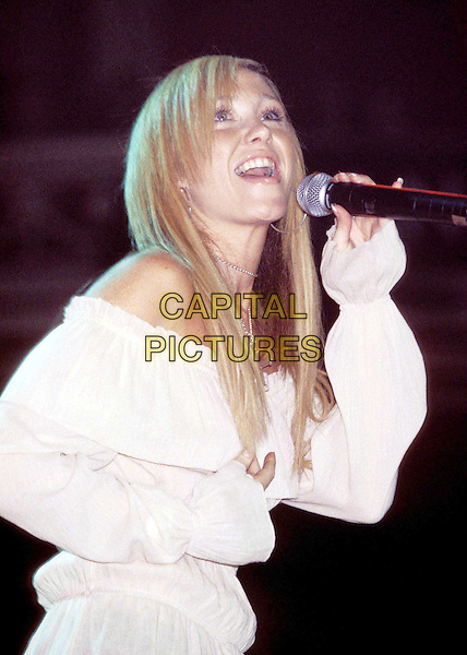 ATOMIC KITTEN   ..Perform at the Grand Prix party..Ref: 11454..half length, half-length, white blouse, off the shoulder, singing, music, concert, live, stage..www.capitalpictures.com..sales@capitalpictures.com..©Capital Pictures..