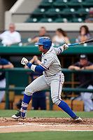 St. Lucie Mets first baseman Jhoan Urena (24) follows through on a swing during the first game of a doubleheader against the Lakeland Flying Tigers on June 10, 2017 at Joker Marchant Stadium in Lakeland, Florida.  Lakeland defeated St. Lucie 6-5 in fourteen innings.  (Mike Janes/Four Seam Images)