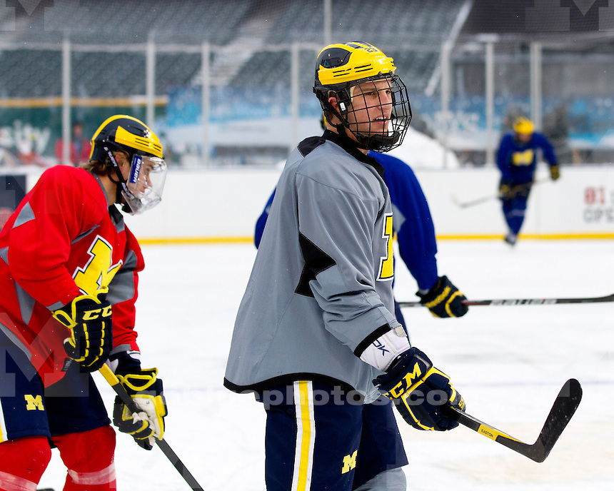 The Michigan men's ice hockey team practices on the outdoor rink at Progressive Field in Cleveland, Ohio on January 14, 2012 for the Frozen Diamond Faceoff.