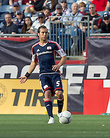 New England Revolution defender AJ Soares (5) passes the ball. In a Major League Soccer (MLS) match, DC United defeated the New England Revolution, 2-1, at Gillette Stadium on April 14, 2012.
