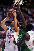 Real Madrid's player Felipe Reyes and Othello Hunter and Unicaja Malaga's player Viny Okouo during match of Liga Endesa at Barclaycard Center in Madrid. September 30, Spain. 2016. (ALTERPHOTOS/BorjaB.Hojas) /NORTEPHOTO