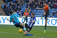 Courtney Baker-Richardson of Swansea City (R) has his shot blocked by Keiren Westwood and Tom Lees of Sheffield Wednesday during the Sky Bet Championship match between Sheffield Wednesday and Swansea City at Hillsborough Stadium, Sheffield, England, UK. Saturday 23 February 2019