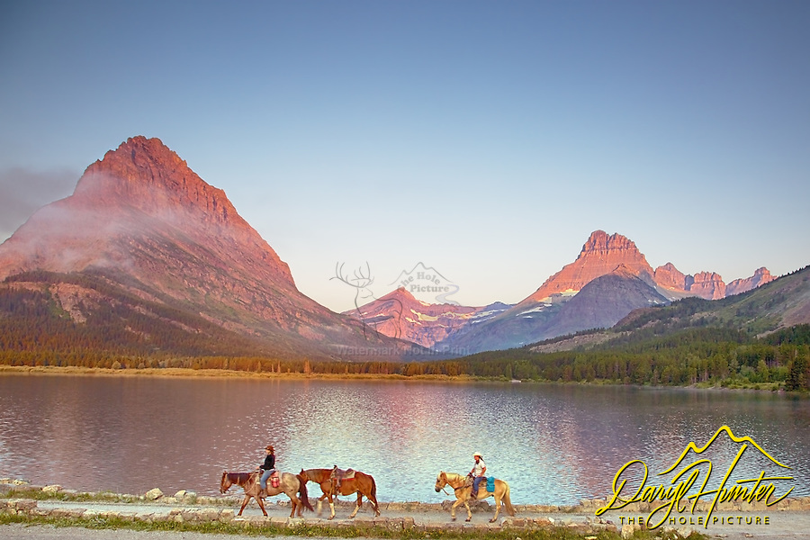 Horseback riders, Swiftcurrent Lake, sunrise, Glacier National Park