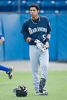 Gabriel Noriega #5 of the Pulaski Mariners removes his batting gloves after having been called out on strikes to end an inning at Burlington Athletic Park August 4, 2009 in Burlington, North Carolina. (Photo by Brian Westerholt / Four Seam Images)