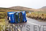 Truck overturned in high winds near camp.