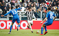 Calcio, Serie A: Juventus - Sassuolo, Torino, Allianz Stadium, 4 Febbraio 2018. <br /> Juventus' Federico Bernardeschi (c) in action with Sassuolo's Federico Peluso (l) and Francesco Acerbi (r) during the Italian Serie A football match between Juventus and Sassuolo at Torino's Allianz stadium, February 4, 2018.<br /> UPDATE IMAGES PRESS/Isabella Bonotto