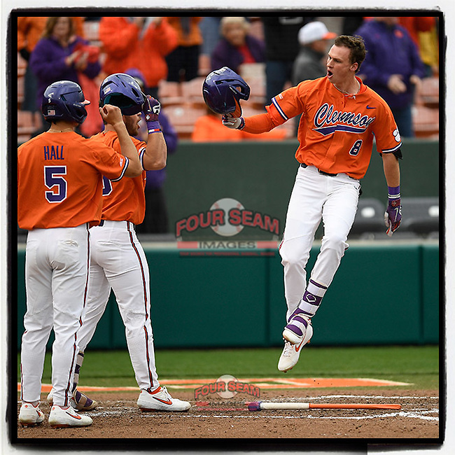 Shortstop Logan Davidson (8) of the Clemson Tigers crosses the plate after hitting a three-run home run in a game against the South Alabama Jaguars on Opening Day, Friday, February 15, 2019, at Doug Kingsmore Stadium in Clemson, South Carolina. Clemson won, 6-2. (Tom Priddy/Four Seam Images)
