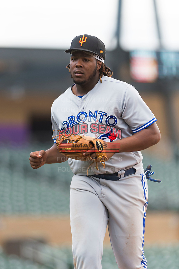 Surprise Saguaros third baseman Vladimir Guerrero Jr. (27), of the Toronto Blue Jays organization, jogs off the field between innings of an Arizona Fall League game against the Salt River Rafters at Salt River Fields at Talking Stick on October 23, 2018 in Scottsdale, Arizona. Salt River defeated Surprise 7-5 . (Zachary Lucy/Four Seam Images)