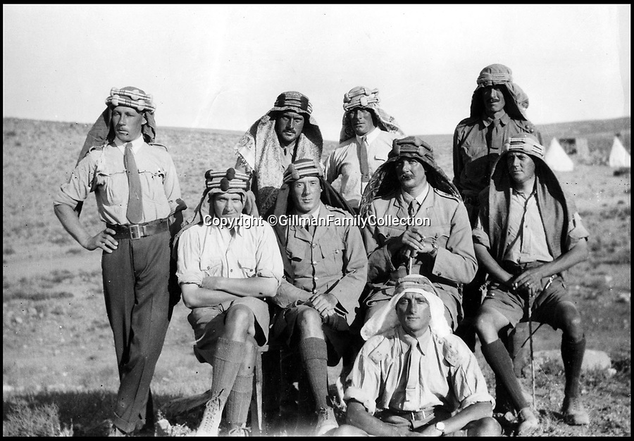 Bournemouth News (01202 558833)<br /> Pic: GilmanFamilyCollection/BNPS<br /> <br /> The officers of Operation Hedgehog - the Briish attack on the Hejaz railway.<br /> F: Grisenthwaite <br /> L to R seated: Ramsey, Gilman, Joyce, Lony <br /> Back: Greenhill, Young, 'FlannelFeet', Bamford. <br /> <br /> Fascinating never before seen photos of the Arab Revolt have revealed Lawrence of Arabia actually had help from a plucky band of British troops as well as the Arab tribesmen.<br /> <br /> A new book reveals the legendary campaign, that did much to shape the modern map of the Middle East, used cutting edge weapons like Rolls Royce armoured car's and British crewed aircraft to attack the Turkish enemy alongside the native arab army.<br /> <br /> The photos feature in military historian James Stejskal's new book Masters of Mayhem which sheds new light on T.E Lawrence's achievements fighting alongside Arab guerrilla forces in the Middle East during the First World War.<br /> <br /> They had been tucked away in the private photo albums of the descendants of soldiers who fought alongside Lawrence during the campaign.<br /> <br /> One historically important photo shows Lawrence and his driver sitting in a Rolls Royce in Marjeh Square in Damascus after it was captured in October 1918.<br /> <br /> Another documents the dramatic moment a water tower and windmill pump are blown up in the desert.