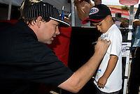 Jul. 26, 2013; Sonoma, CA, USA: NHRA funny car driver Del Worsham signs an autograph during qualifying for the Sonoma Nationals at Sonoma Raceway. Mandatory Credit: Mark J. Rebilas-