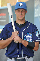 Dustin Garneau #15 of the Asheville Tourists poses during media day at McCormick Field on April 4, 2011 in Asheville, North Carolina.  Photo by Tony Farlow / Four Seam Images..