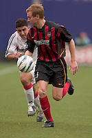 The MetroStars' Chris Leitch is chased by D.C. United's Alecko Eskandarian. D. C. United was defeated by the NY/NJ MetroStars 3 to 2 during the MetroStars home opener at Giant's Stadium, East Rutherford, NJ, on April 17, 2004.