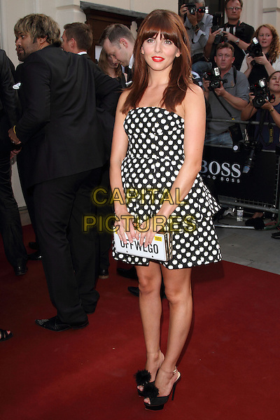 Ophelia Lovibond<br /> GQ Men of the Year Awards 2013 at the Royal Opera House, London, England.<br /> 3rd September 2013<br /> full length black dress strapless white polka dot clutch bag shoes peep toe license plate off we go<br /> CAP/ROS<br /> &copy;Steve Ross/Capital Pictures
