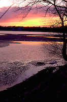 Partially frozen Lake Harriet at sunset.  Minneapolis Minnesota USA