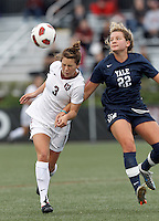 Harvard University midfielder Meg Casscells-Hamby (3) heads the ball as Yale University defender Shannon McSweeney (22) closes. In overtime, Harvard University defeated Yale University,1-0, at Soldiers Field Soccer Stadium, on September 29, 2012.