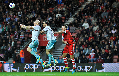 15.09.2013 Southampton, England.    James Collins  of West Ham, Joey O'Brien  of West Ham and Rickie Lambert of Southampton during the Premier League game between Southampton and West Ham United from St Mary's Stadium.