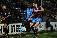 Fleetwood Town's forward Devante Cole (44) is beaten to the ball by Scunthorpe Utd's defender Murray Wallace (5) during the Sky Bet League 1 match between Scunthorpe United and Fleetwood Town at Glanford Park, Scunthorpe, England on 17 October 2017. Photo by Stephen Buckley/PRiME Media Images