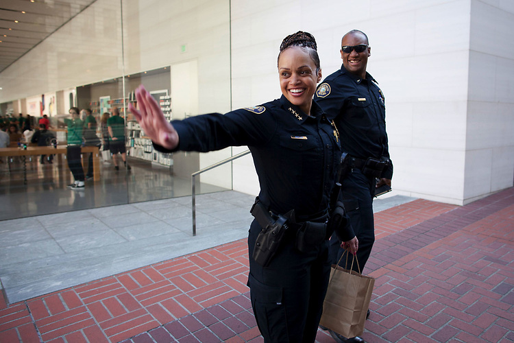 Portland Police Bureau Chief Danielle Outlaw waves to a person in downtown Portland as she heads to City Hall to meet with Mayor Ted Wheeler with Adjutant Sgt. Chuck Lovell.<br /> Photo by Jaime Valdez
