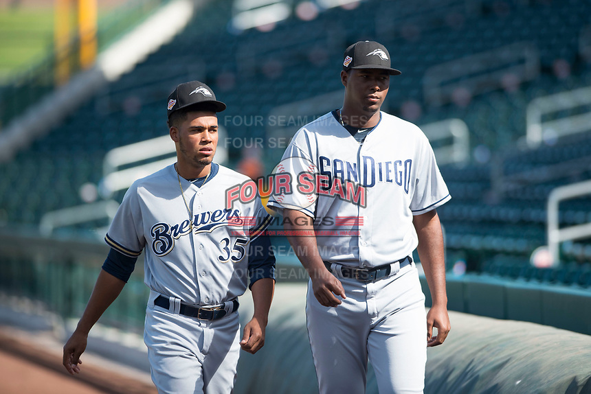 Peoria Javelinas pitchers Miguel Sanchez (35) and Dauris Valdez (50) walk towards the dugout before an Arizona Fall League game against the Mesa Solar Sox at Sloan Park on October 24, 2018 in Mesa, Arizona. Mesa defeated Peoria 4-3. (Zachary Lucy/Four Seam Images)