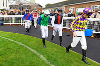 Jockeys enter The Parade Ring during Evening Racing at Salisbury Racecourse on 11th June 2019