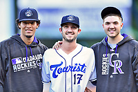 Asheville Tourists pitchers Julian Fernandez (22), Kenny Oakley (17) and Riley Pint (32) pose for a photo before the game against the Greenville Drive at McCormick Field on September 5, 2017 in Asheville, North Carolina. The Tourists defeated the Drive 4-2. (Tony Farlow/Four Seam Images)