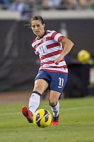 February 9, 2013:   USA Women's National Team defender Ali Krieger (11) makes a kick during action between the USA Women's National Team and Scotland at EverBank Field in Jacksonville, Florida.  USA defeated Scotland 4-1............