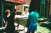 Family carrying grandma in home made wooden coffin age 30 and 60.  WesternSprings Illinois USA