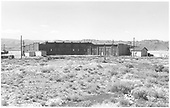 Panoramic view of D&amp;RGW Gunnison roundhouse with doors closed, after abandonment.  No equipment in sight.<br /> D&amp;RGW  Gunnison, CO  Taken by Richardson, Robert W. - 1955