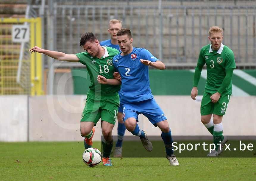20150331 - MANNHEIM, Germany :<br /> <br /> Duel between Irish Ryan Goldsmith (18) and Slovakian Andrej Kadlec (2)<br /> , pictured during the soccer match between Under 19 teams of Republic of Ireland and Slovakia , on the third and last matchday  in Group 2 of the UEFA Elite Round Under 19 at the Carl-Benz Stadium, Mannheim, Germany<br /> <br /> Thursday 31 march 2015<br /> foto Dirk Vuylsteke / David CATRY
