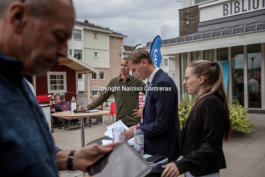 August 30, 2018: ROGER HEDLUND, a 38 years-old MP and member of the SD board in Gävle municipality for the Swedish Democrats (Sverigedemokraterna) and LIZ ZACHARIASSON, a 27 years-old member of the SD since 2009, get ready prior to a public debate held in Ockelbo city with members of the Social Democrats party (Socialdemokraterna) -not pictured-, Roger and Liz are running for the Gälve and the Ockelbo municipality respectively.