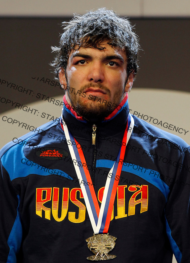 BELGRADE, SERBIA - MARCH 06: Goold medalist Abdusalam Gadisov of Russia pose on the podium during the medal ceremony of  Men's Freestyle 96kg during the European wrestling championship March 06, 2011 in Belgrade, Serbia.(Photo by Srdjan Stevanovic/Getty Images)