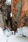 Following a crevice going back into the cliff at the Apostle Islands Ice Caves.