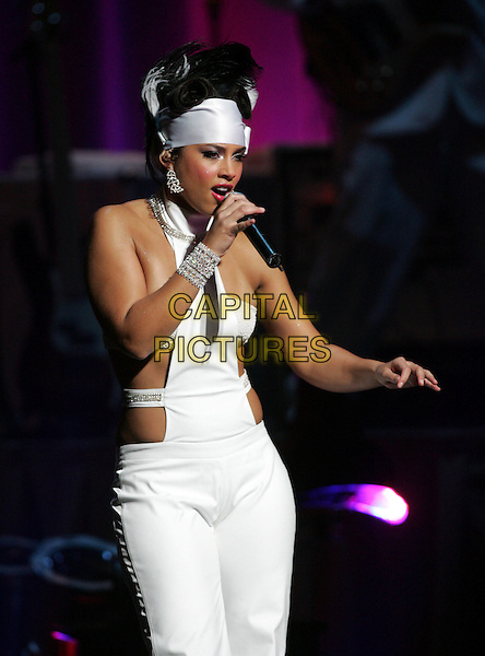 ALICIA KEYS.Performing to a sold out crowd at The Kodak Theatre in Hollywood, California..March 16th, 2005.half length white  cut out cut away headband  bracelet halterneck singing.www.capitalpictures.com.sales@capitalpictures.com.Supplied By Capital PIctures