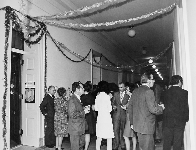 Congressmen and staff members enjoying a Christmas party. (Photo by Dev O'Neill/CQ Roll Call via Getty Images)