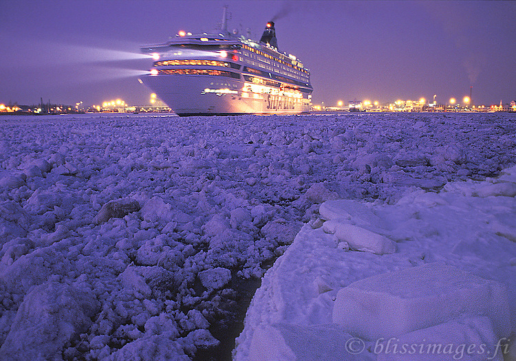 Silja Europa departs ice-jammed Turku harbour at twilight.