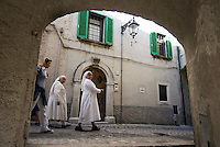 Abruzzo National Park, Italy, June 2008. 2 catholic nuns walk through the town. The Medieval Village of Barrea with its narow winding streets overlooks the lake. Photo by Frits Meyst/Adventure4ever.com