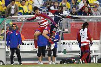 FC Dallas assistant coach Marco Ferruzzi watches as FC Dallas midfielder Juan Toja (8) and New England Revolution midfielder Sainey Nyassi (31) go up for a header. The New England Revolution defeated FC Dallas 2-1 during a Major League Soccer match at Gillette Stadium in Foxborough, MA, on June 6, 2008.