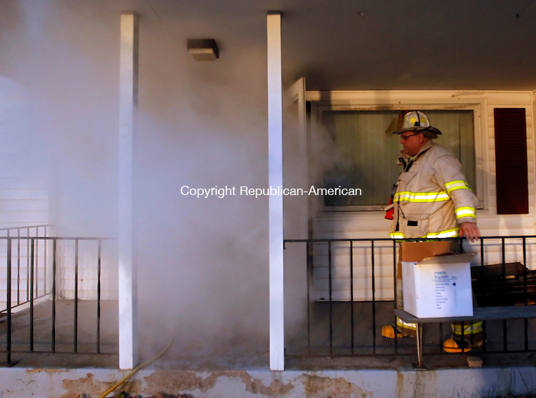 Terryville, CT-07 May 2012-050712CM06-  Terryville Volunteer Fire Department Chief, Mark Sekorski shows the degree of fog generated from a machine during a SCBA (self contained breathing apparatus) training exercise at a house next to the Terryville Chevrolet car dealership Monday night.  Volunteers firefighters from the department were subjected to a fog machine that simulated a real life smoke situation.   Christopher Massa Republican-American