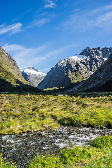 View of Monkey Creek and majestic mountains just off Milford Road, Fiordland, New Zealand