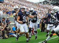 17 September 2016:  Penn State's Mike Gesicki (88), Juwan Johnson (84), Brandon Polk (10), and Irvin Charles (11) celebrates with QB Trace McSorley (9) after he dove to the pylon for a rushing touchdown. The Penn State Nittany Lions defeated the Temple Owls 34-27 at Beaver Stadium in State College, PA. (Photo by Randy Litzinger/Icon Sportswire)