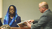 Mildred Muhammad, ex-wife, of convicted sniper John Allen Muhammad, answers questions from Prince William county Commonwealth Attorney Paul S. Ebert, right, as she begins her testimony in the penalty phase of the trial in Virginia Beach Circuit Court in Virginia Beach, Virginia on November 19, 2003.   Now in the punishment phase of the trial, the jury can only choose execution or life in prison without parole for Muhammad, who was found guilty Monday, November 17, 2003 of all charges, including two capital murder counts, in one of 10 fatal shootings that terrorized the Washington, D.C., area in 2002. <br /> Credit: Tracy Woodward - Pool via CNP