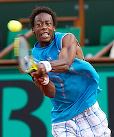 Gael Monfils (FRA) (13) against Fabio Fognini (ITA) in the second round of the men's singles. The match was abandoned dur to bad light at 5-5 in the fifth set with the score 6-2 6-4 5-7 6-4..Tennis - French Open - Day 4 - Wed 26 May 2010 - Roland Garros - Paris - France..© FREY - AMN Images, 1st Floor, Barry House, 20-22 Worple Road, London. SW19 4DH - Tel: +44 (0) 208 947 0117 - contact@advantagemedianet.com - www.photoshelter.com/c/amnimages