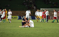 Italy's Marco Calderoni (6) is comforted by a coach after losing to the Hungarian team in overtime during the FIFA Under 20 World Cup Quarter-final match at the Mubarak Stadium  in Suez, Egypt, on October 09, 2009. Hungary won 2-3 in overtime.