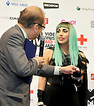 Hiroshi Mizohata and Lady Gaga, Jun 23, 2011 : Lady Gaga, Tokyo, Japan, June 23, 2011 : Commissioner Japan Tourism Agency , Hiroshi Mizohata (C), and Lady Gaga(R) attend a press conference in Tokyo, Japan, on June 23, 2011.