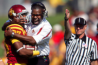Iowa State assistant coach Jay Boulware embraces Iowa State defensive back Leonard Johnson after he made a second quarter interception against Kansas Saturday, October 4, 2008 at Jack Trice Stadium in Ames, Iowa.