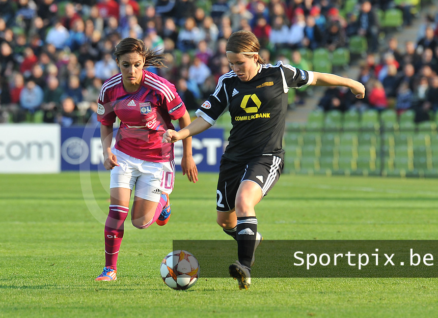 Uefa Women 's Champions League Final 2012 at Olympiastadion Munchen : Olympique Lyon -  FC Frankfurt : Meike Weber aan de bal voor Louisa Necib..foto DAVID CATRY / JOKE VUYLSTEKE / Vrouwenteam.be