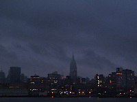 New York, NY - 12 September 2009 - 6:32 am the skyline with the Empire Stete Building lost in rain clouds and fog